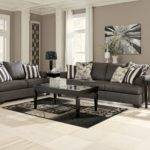 Buy Levon Charcoal Sofa Signature Design