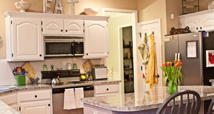 Tips Decorating Above Kitchen Cabinets