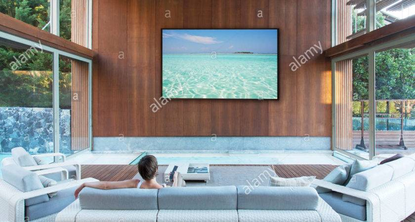 Woman Watching Large Flat Screen Modern Living Room