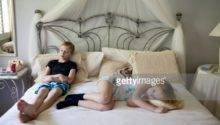 Young Boy Girl Relaxing Bed Getty